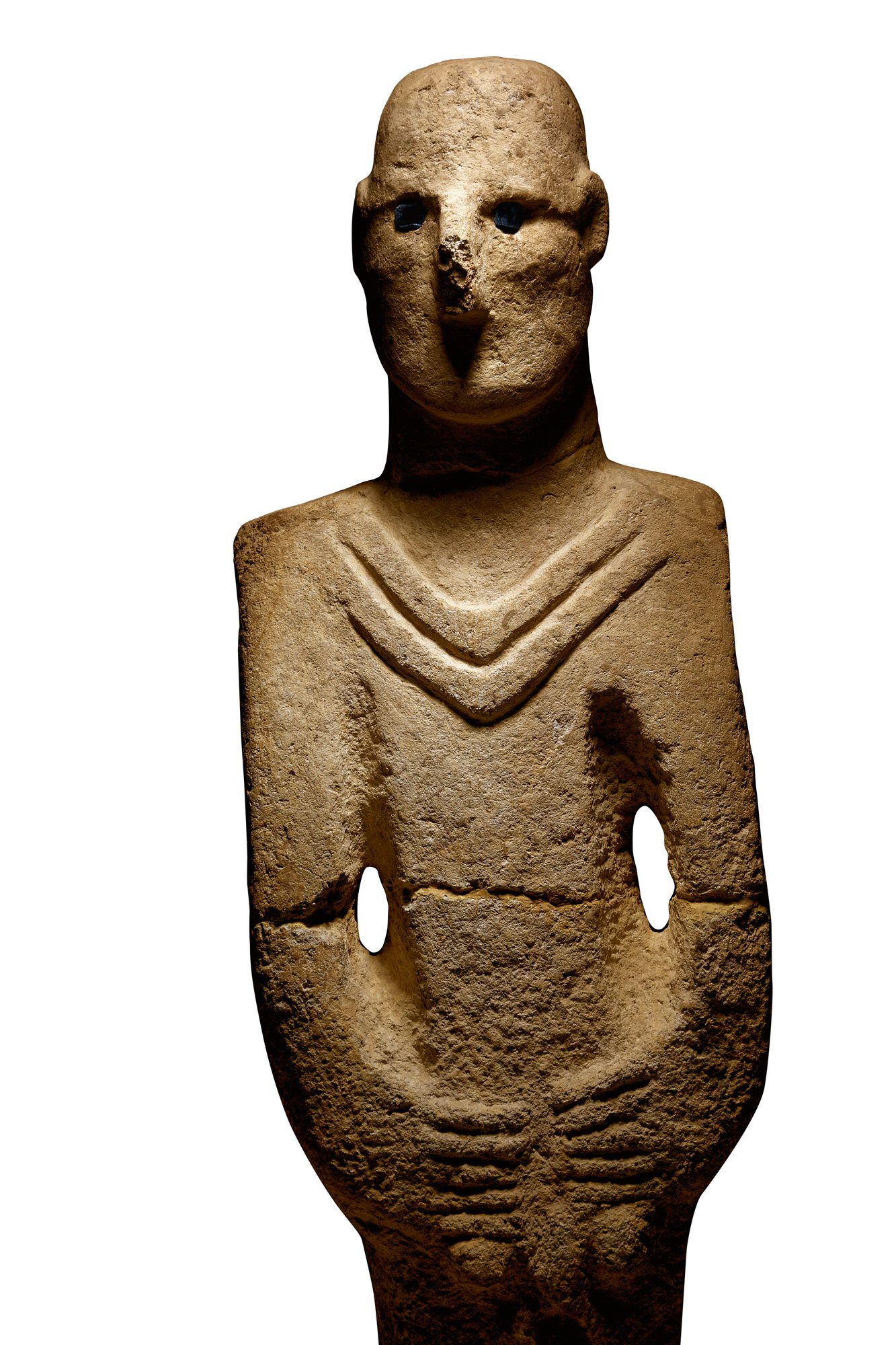 "Göbekli Tepe (en turco ""Colina panzuda"") Representacion_de_un_ser_humano_en_piedra_localizada_cerca_de_gobekli_tepe_1333x2000"