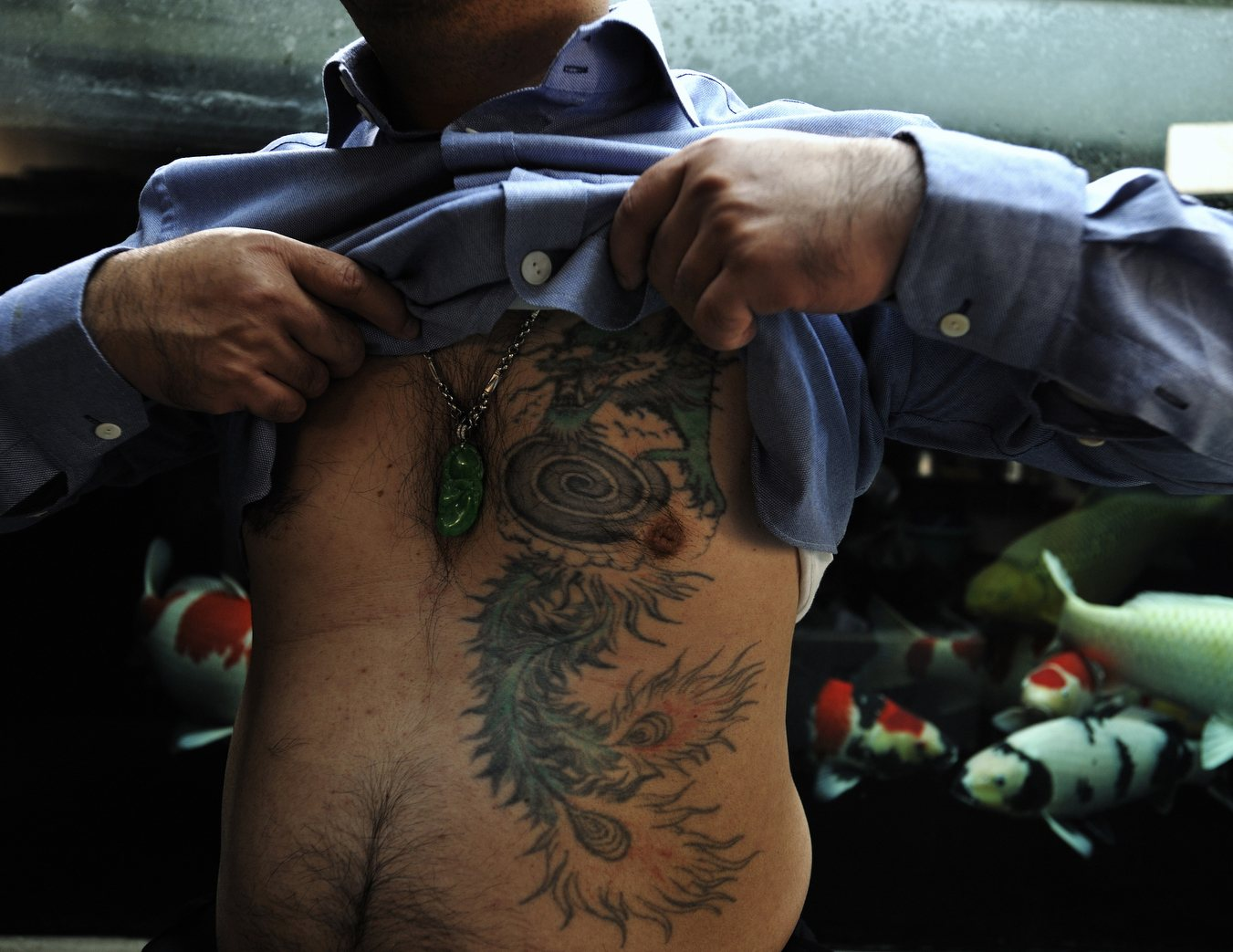 07-dragon-tattoo-on-gang-member. Hong Kong