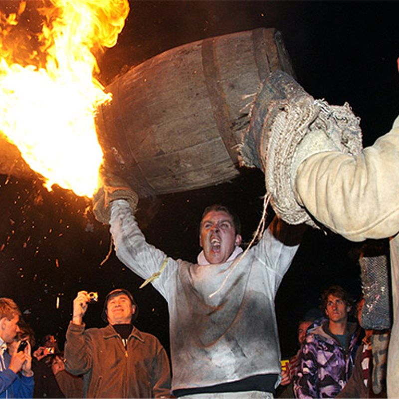Tar Barrel held aloft