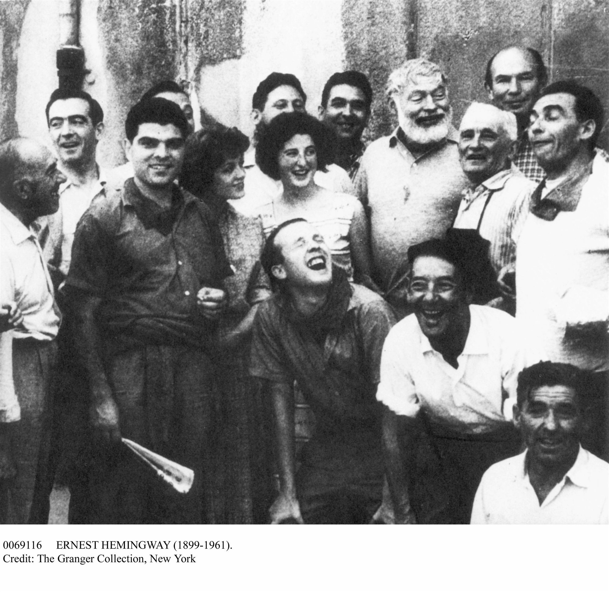 ERNEST HEMINGWAY (1899-1961). American writer, at right with beard, photographed in a crowd at Pamplona, Spain, July 1959.. El escritor americano Ernest Hemingway en Pamplona, España,  en julio de 1959.