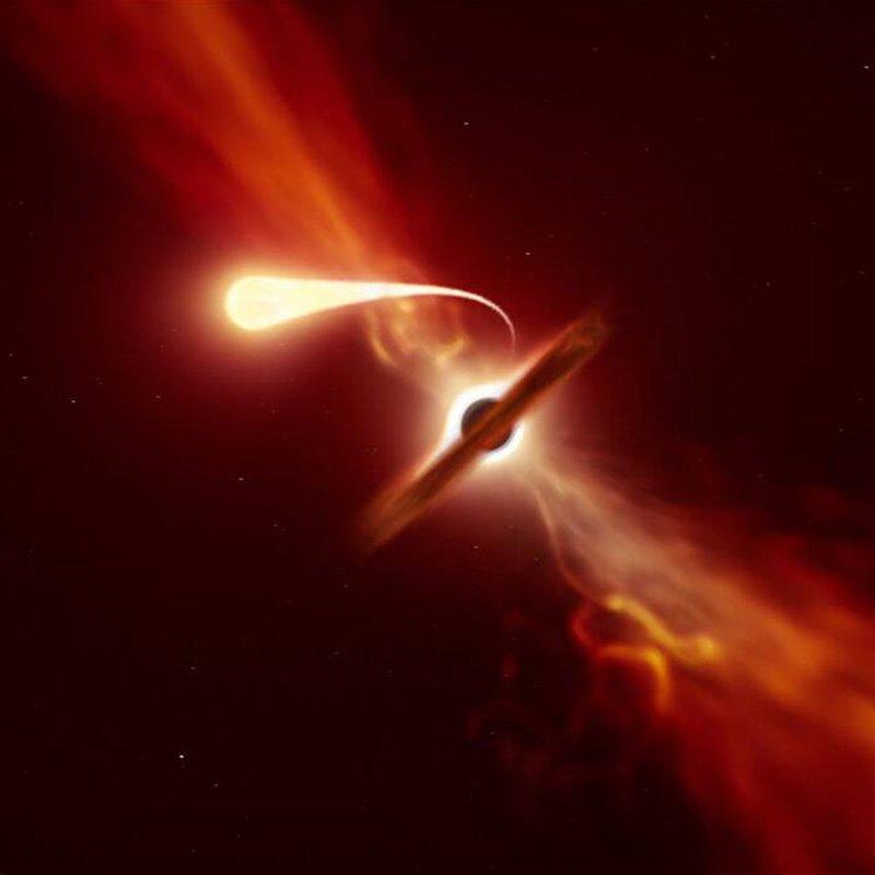 Representación artística de una estrella experimentando espaguetificación al ser absorbida por un agujero negro supermasivo durante un evento de disrupción de marea.